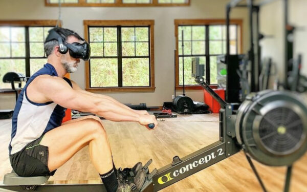 Man using Holofit VR headset with Concept 2 rowing machine